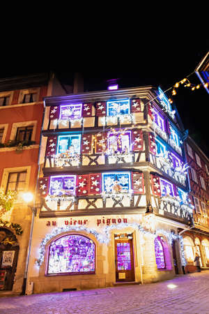 Colmar, France - december 1, 2019: Traditional Alsatian half-timbered houses in Petite Venise or little Venice, Colmar, decorated at christmas time, Alsace, France