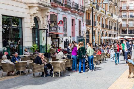 Huelva, Spain - April 1, 2021: People sitting in terrace of a cafe and bar in the square Plaza de las Monjas (Nuns square) of Huelva Redakční