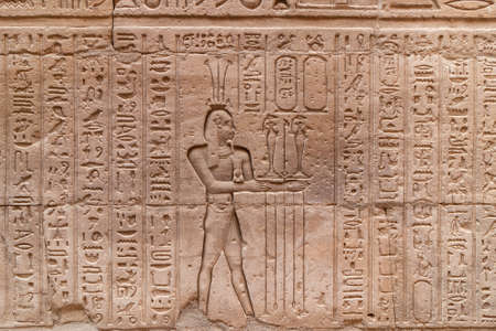 Hieroglyphs in a wall of Ruins of Temple of Horus at Edfu - Egypt