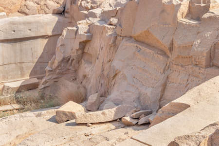 Pink granite quarry used in ancient Egypt for obelisk carving in the city of Aswan, Egypt