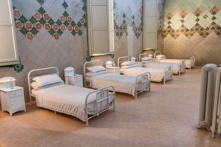 Barcelona, Spain - September 19, 2021: Ancient hospital patients room in Sant Pau hospital in Barcelona with beds