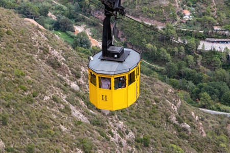Montserrat, Spain - September 21, 2021: Cable car cabin that goes up to the Montserrat mountain in which are located the abbey and monastery of Montserrat Redactioneel