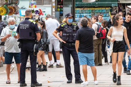 Barcelona, Spain - September 21, 2021: Barcelona Municipal Police helping citizens and tourists with their queries