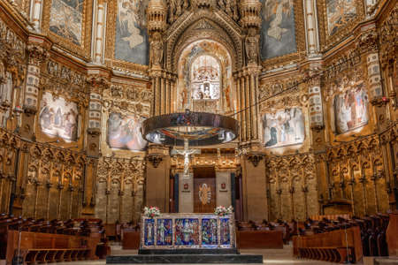 Montserrat, Spain - September 21, 2021: Main altar and altarpiece of the Basilica of Montserrat in Barcelona, catalonia, Spain