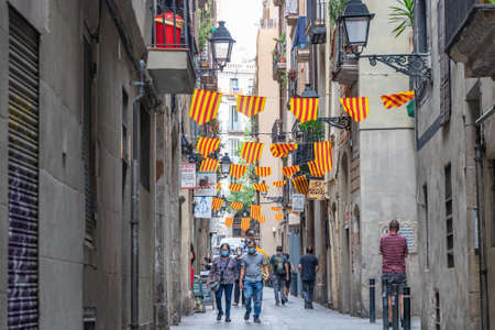 Barcelona, Spain - September 27, 2021: Barcelona street decorated with flags of Catalonia