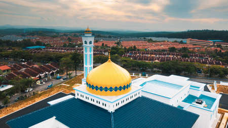 The minarat of a mosque during sunrise in Malaysia