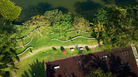 Drone top down view aerial photograph of a Malaysian eco park during the evening with public exercise equipments