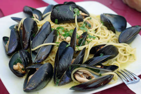 A seafood spaghetti with mussels meal in an Italian restaurant, Sicily