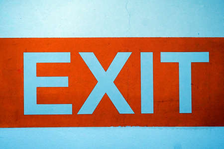 The word EXIT written on a white wall