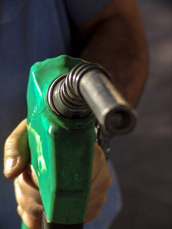 alf: Sao Paulo, Brazil, August 15, 2007. Gas nozzle in mans hand
