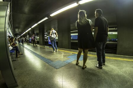 Sao Paulo, Brazil, October 29, 2019: People waiting for the next subway. The system length of 66 km and passenger traffic for day 4 million.