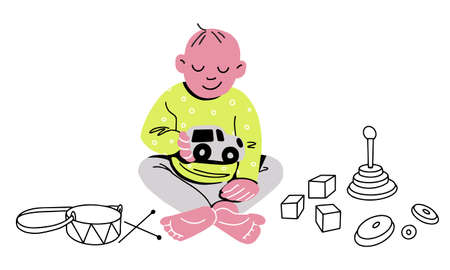 Baby is sitting on the floor and playing with a toy car cubes and a drum lying around. Vector illustration. Flat design