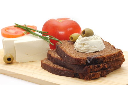 fresh vegetables with dark bread isolated on white background Stock Photo - 13060173