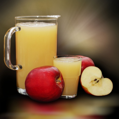 fresh apple juice in glass and slices photo