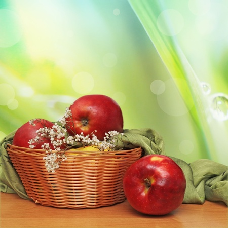 Red and yellow apples in the basket  photo