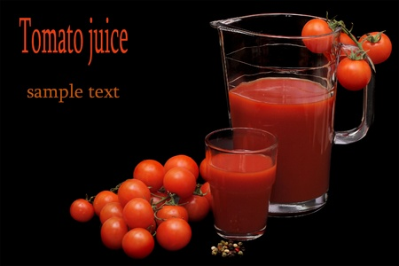 tomatoes, jug and glass full of fresh tomatoes juice photo