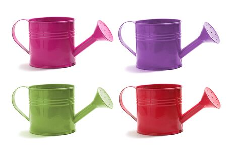 watering can: A set of four watering cans on white in red, green,violet, and pink