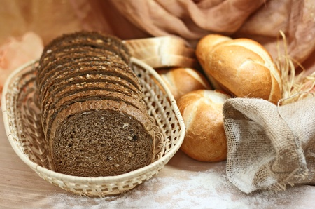 assortment of baked bread on wood table  photo