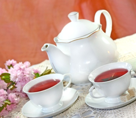 Cups and jug of herbal fruit tea  photo
