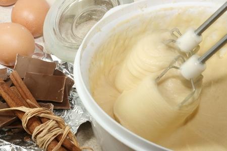 blending: Mixer over bowl of cookie dough