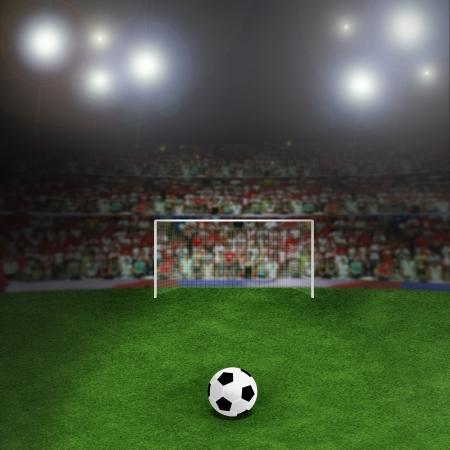 Ballon de football sur le champ vert