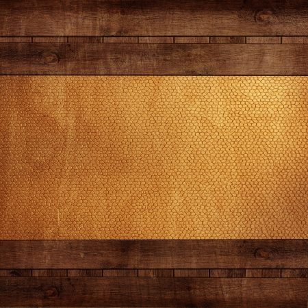 wooden background with yellow leather photo