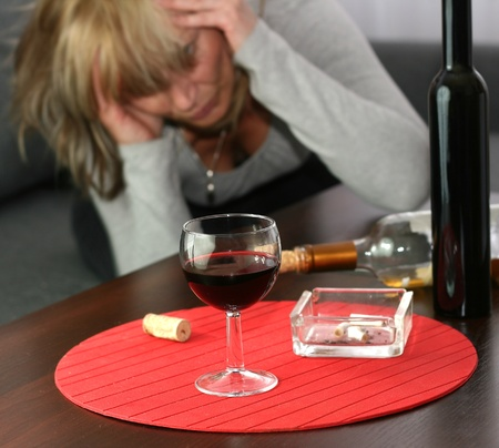 lonely and desperate - portrait of middle-aged woman with addiction problems Stock Photo - 13446617