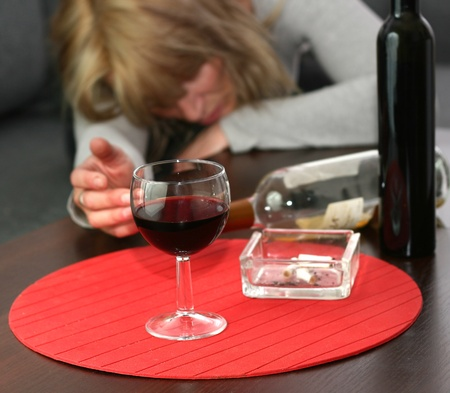 lonely and desperate - portrait of middle-aged woman with addiction problems  photo
