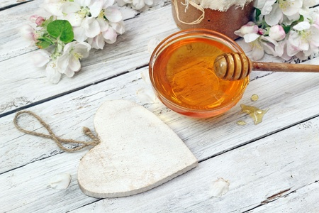 honey jar: Honey in a glass jar and flower sunflower on a wooden table   Stock Photo