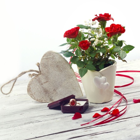 rose ring: red roses, heart and jewelry on wooden table Stock Photo