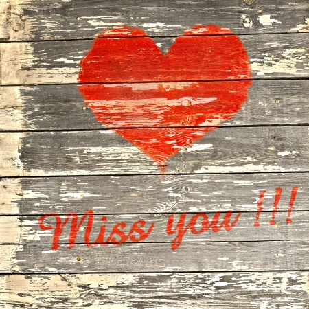 miss you: heart and text: miss you on wooden background