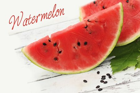 watermelon slices on a wooden table Stock Photo - 14875460