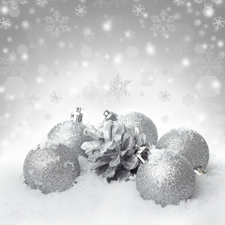 christmas embellishments: Christmas ball baubles with silver decoration on the snow  Stock Photo