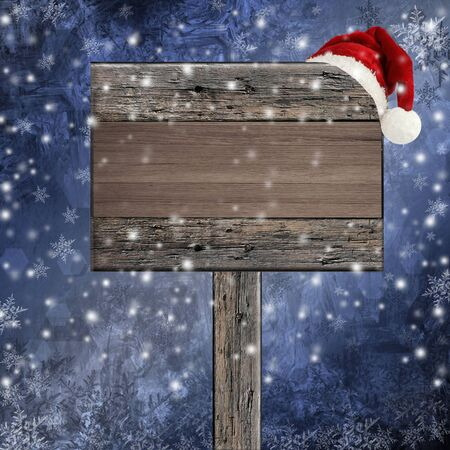 wooden sign with Santa hat on snowy background  photo