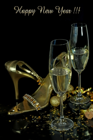 gold party shoes with champagne glasses photo