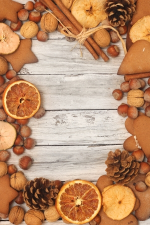 Christmas frame  Christmas spices and dried orange sliceson on wooden background  photo