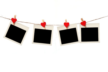 wooden insert: blank instant photo hanging on the clothesline