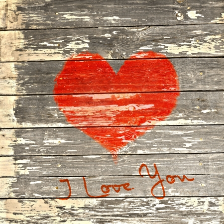 love symbol and word love  you on old wooden wall background  photo