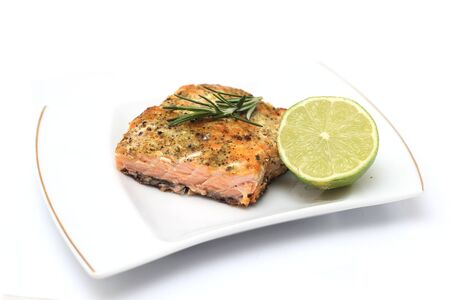 grilled salmon steak over white plate  photo