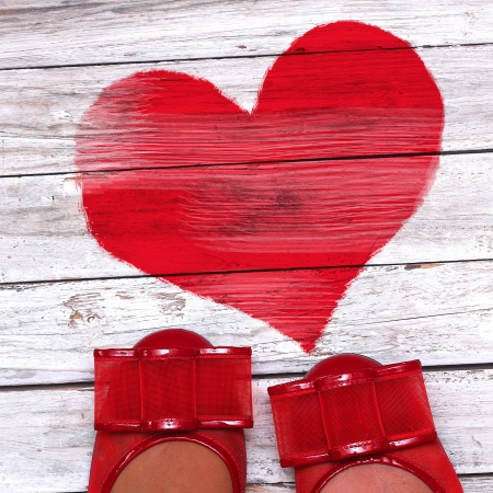 red shoes: wooden background with red heart