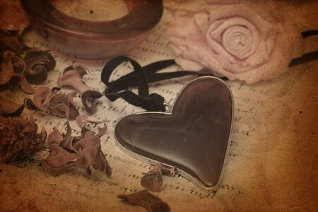 vintage heart and rose on old letter photo
