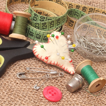 tools for needlework, thread, scissors and tape measure  photo