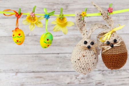easter eggs, rabbit and flowers hanging on the ribbon photo