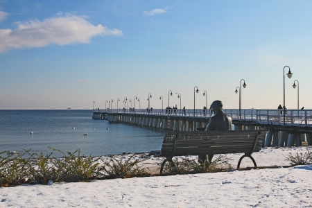 beach wooden pier in baltic sea - Orlowo, Gdynia, Poland  photo