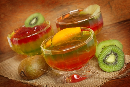 multi layered: Delicious multi - layered fruit jelly made from wild strawberries, peach and slice of kiwi