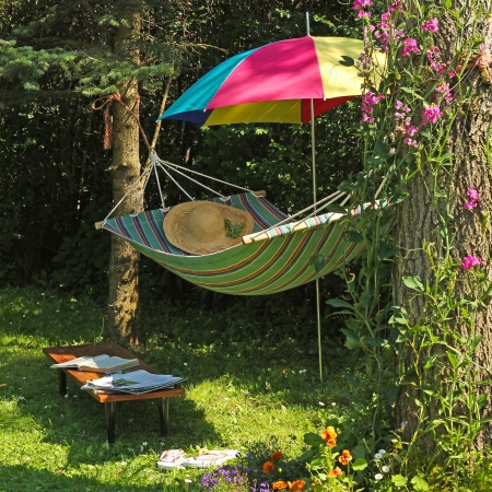 View of hammock and book on a sunny summer day