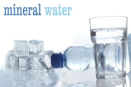 Mineral water in plastic bottle with glass  photo