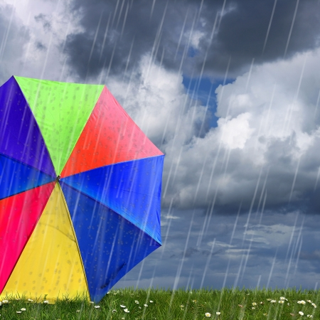 monsoon clouds: rainbow colored umbrellas in heavy rain to use as background