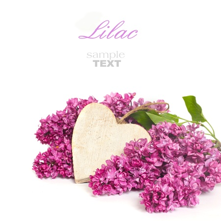 Beautiful Bunch of Lilac with wooden heart photo