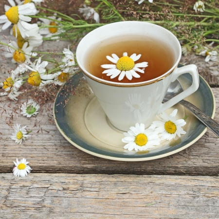 chamomile tea: chamomile tea on wooden background